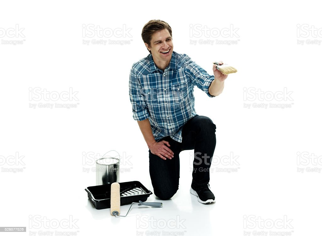 Smiling painter painting stock photo