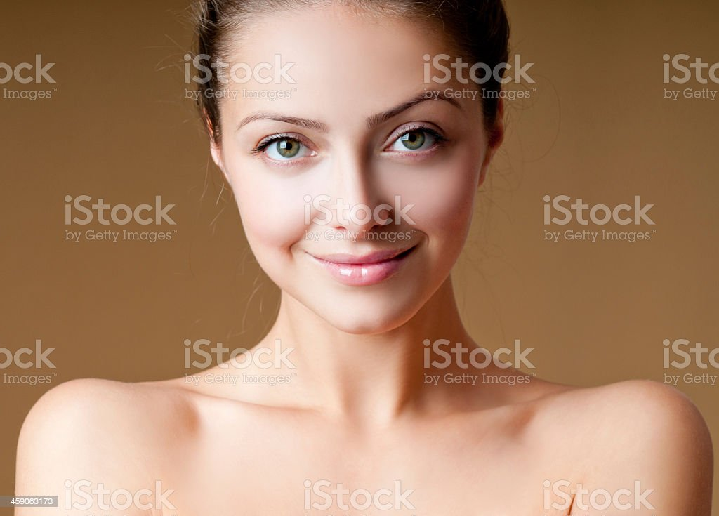 A smiling pale woman with clear skin royalty-free stock photo