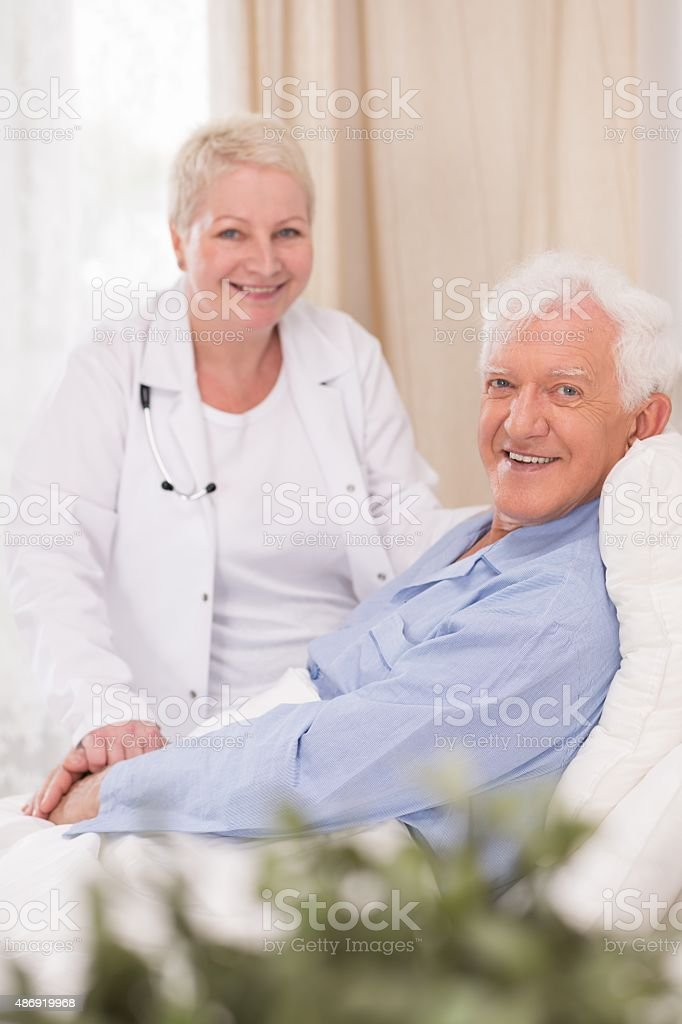 Smiling patient of geriatric ward stock photo