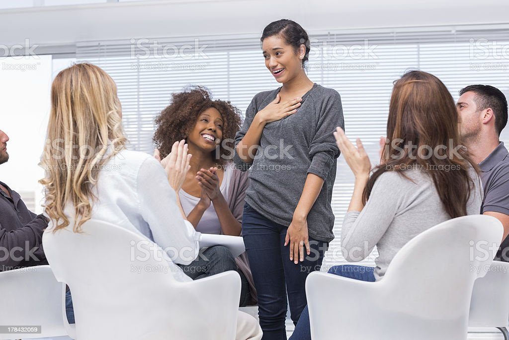 Smiling patient standing and telling her problems royalty-free stock photo