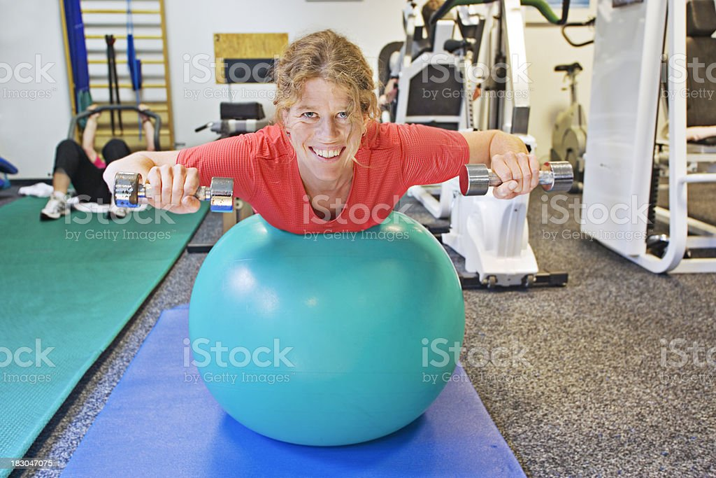 Smiling patient with dumbbell stock photo