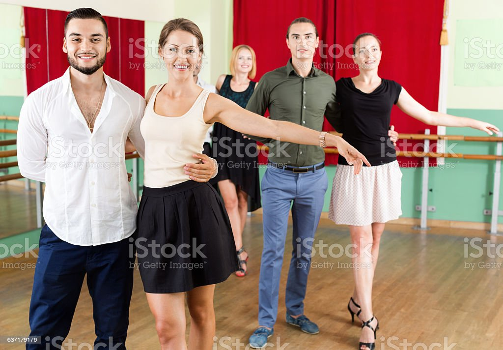 Smiling people dancing waltz stock photo