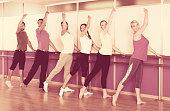 Smiling people rehearsing ballet dance