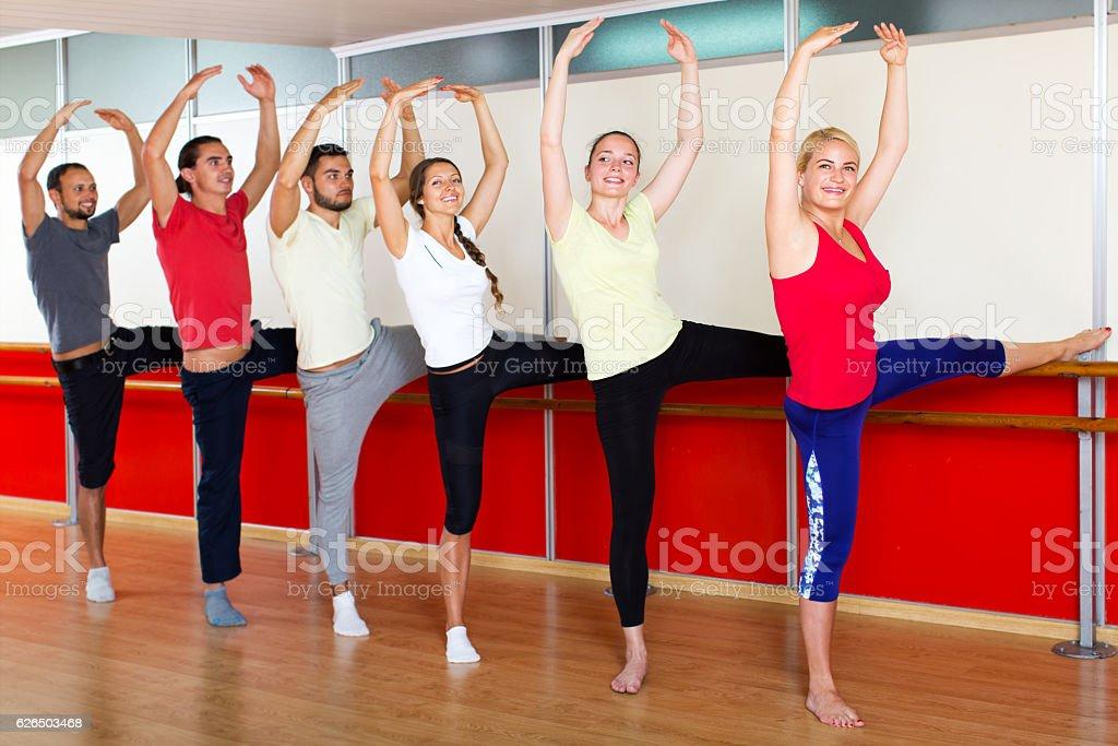 Smiling people rehearsing ballet dance stock photo