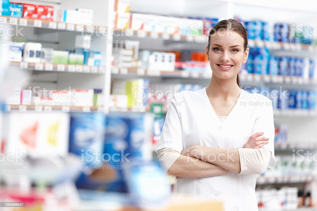 Smiling pharmacist with arms crossed royalty-free stock photo