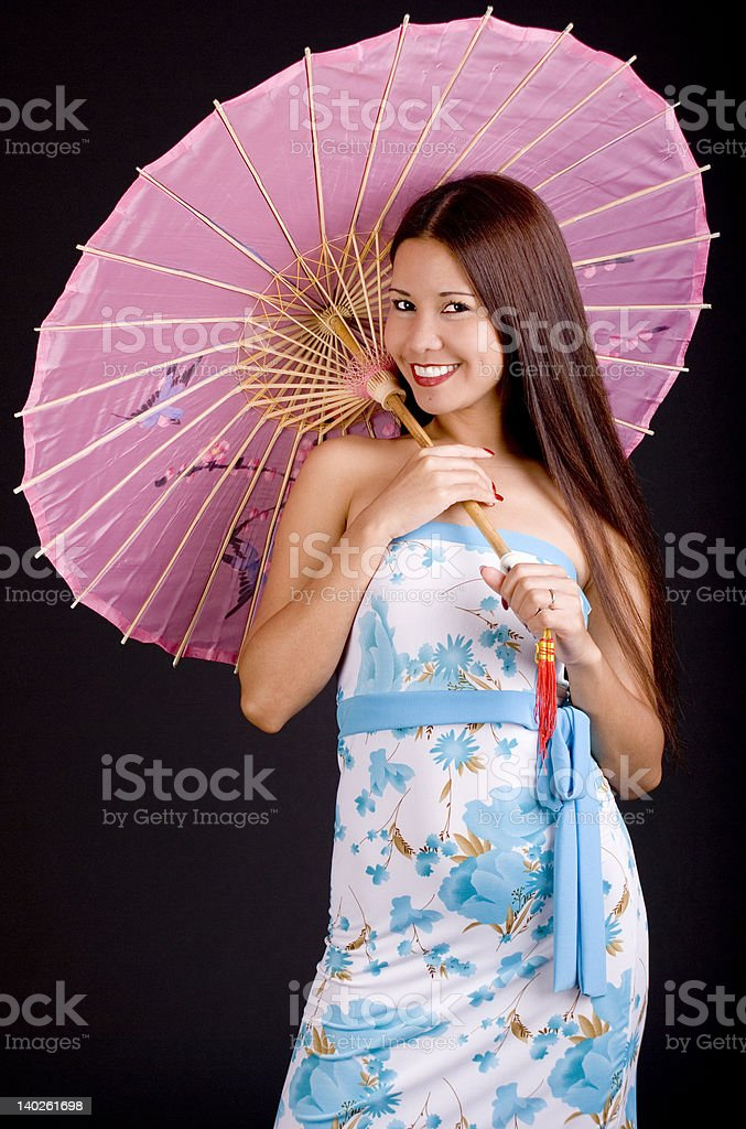 Smiling Philippine girl with parasol royalty-free stock photo