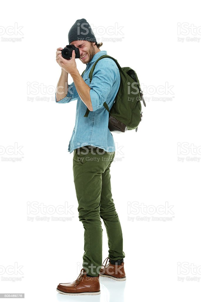 Smiling photographer in action stock photo