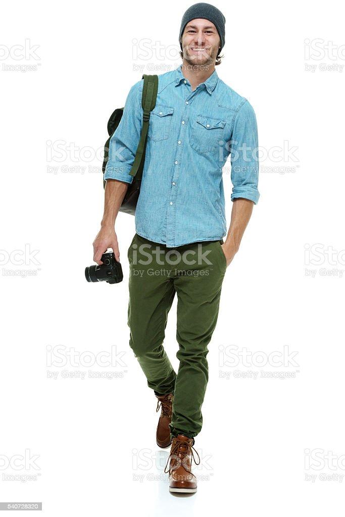 Smiling photographer walking stock photo