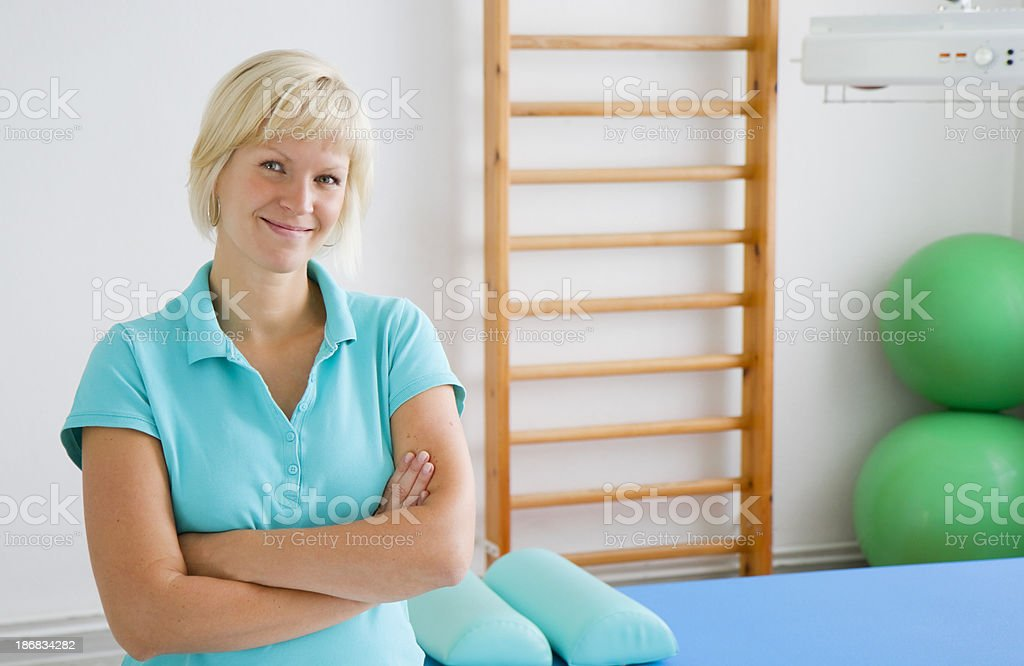 Smiling physiotherapist at work stock photo