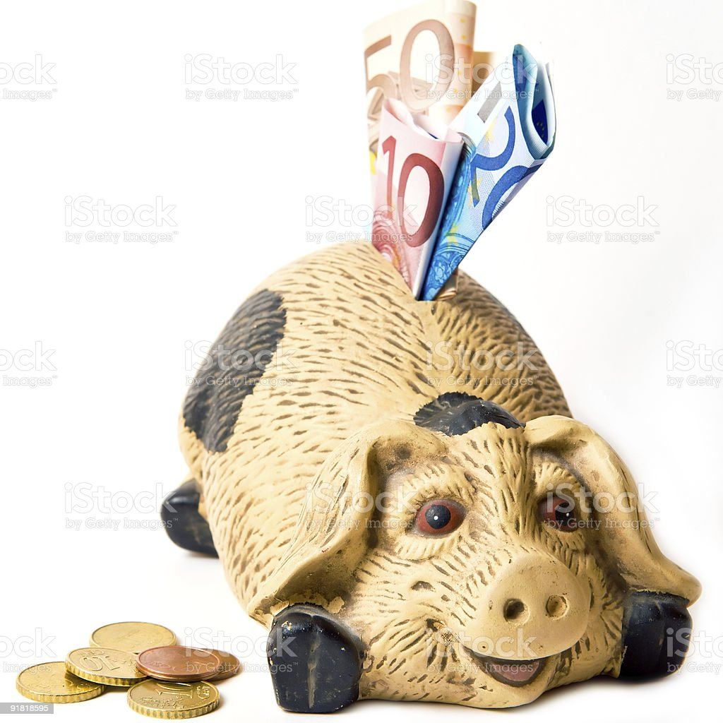 Smiling piggy bank stuffed with euro - isolated on white stock photo