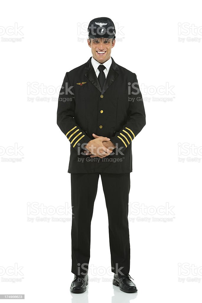 Smiling pilot in uniform royalty-free stock photo