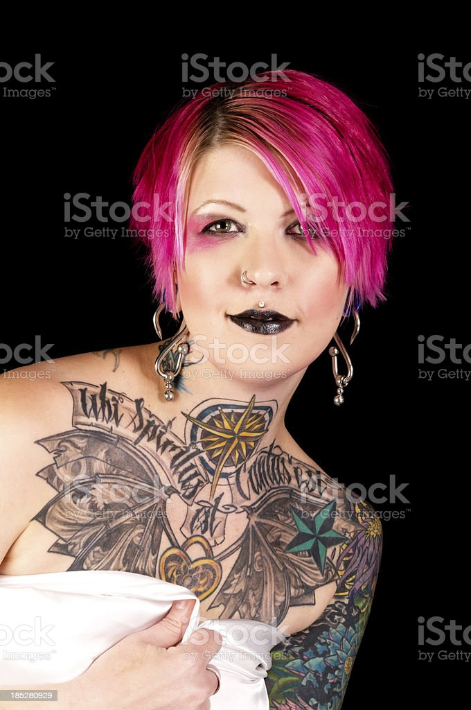 Smiling pink haired woman with tattoos. royalty-free stock photo