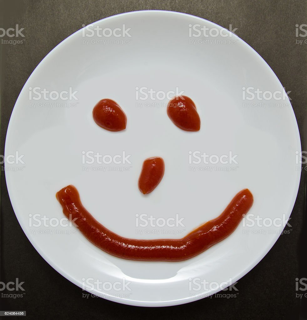 smiling plate on a dark background stock photo