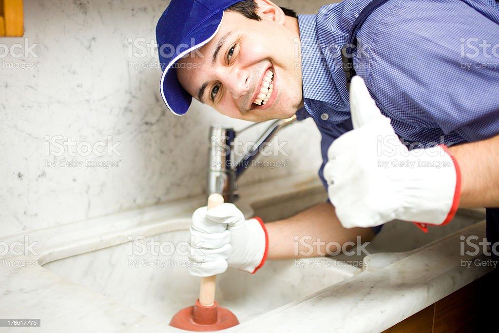 Smiling plumber at work royalty-free stock photo