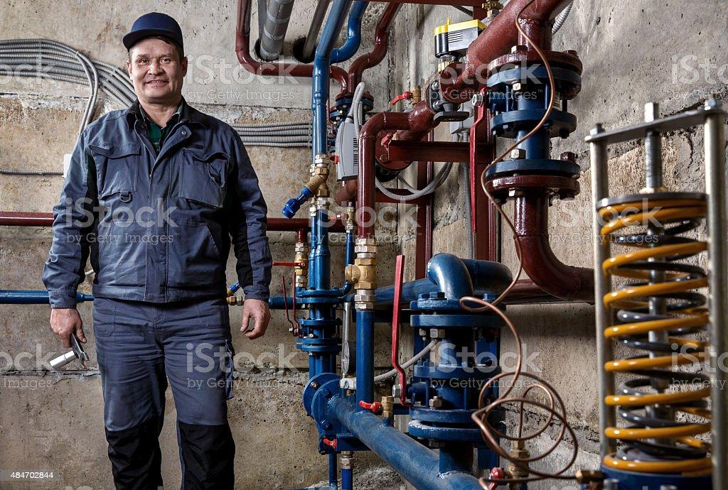 smiling plumber stock photo