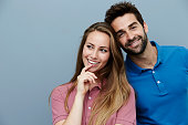 Smiling polo shirt couple in studio