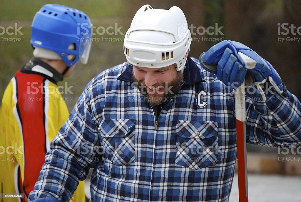 Smiling pond hockey player stock photo