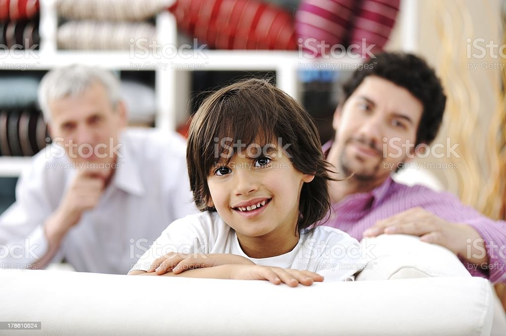 Smiling portrait of son, father and grandfather royalty-free stock photo