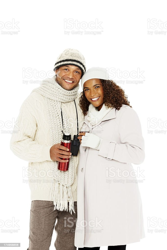 Smiling pregnant couple holding a thermos royalty-free stock photo
