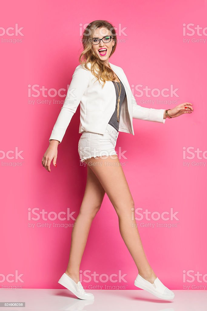 Smiling pretty girl on the pink background. stock photo