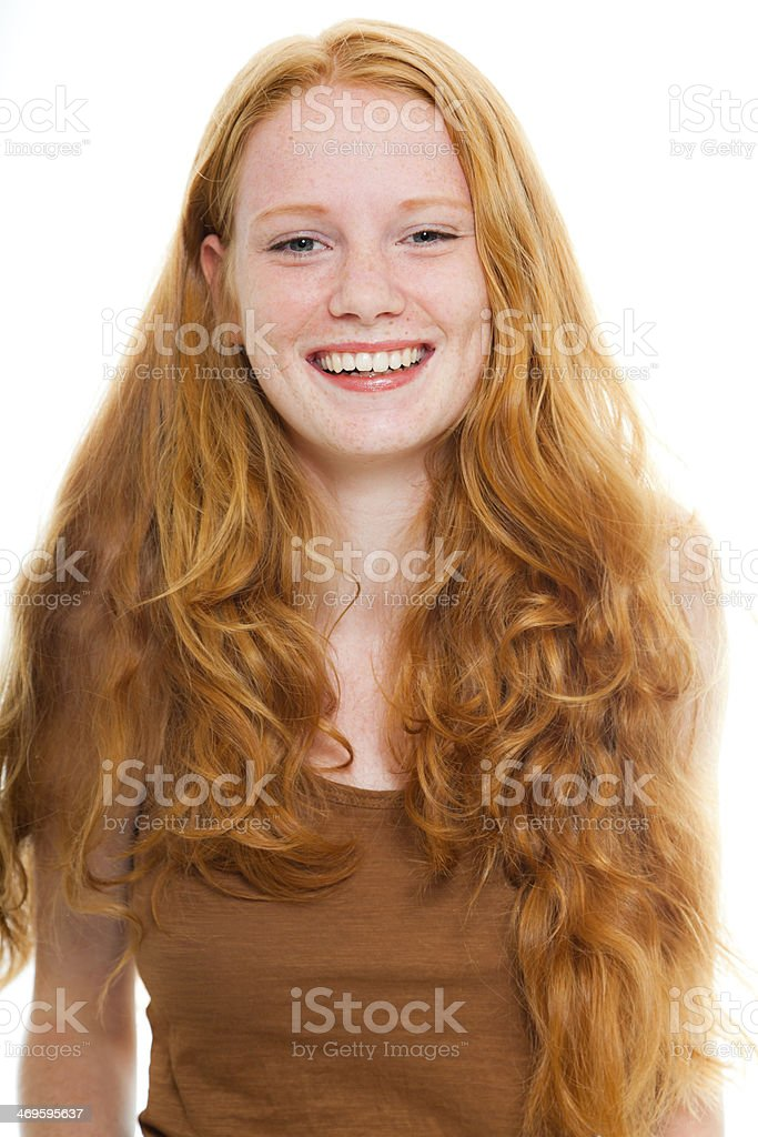 Smiling pretty girl with long red hair wearing brown shirt. royalty-free stock photo