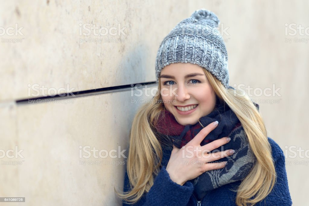 Smiling pretty young woman in a beanie stock photo