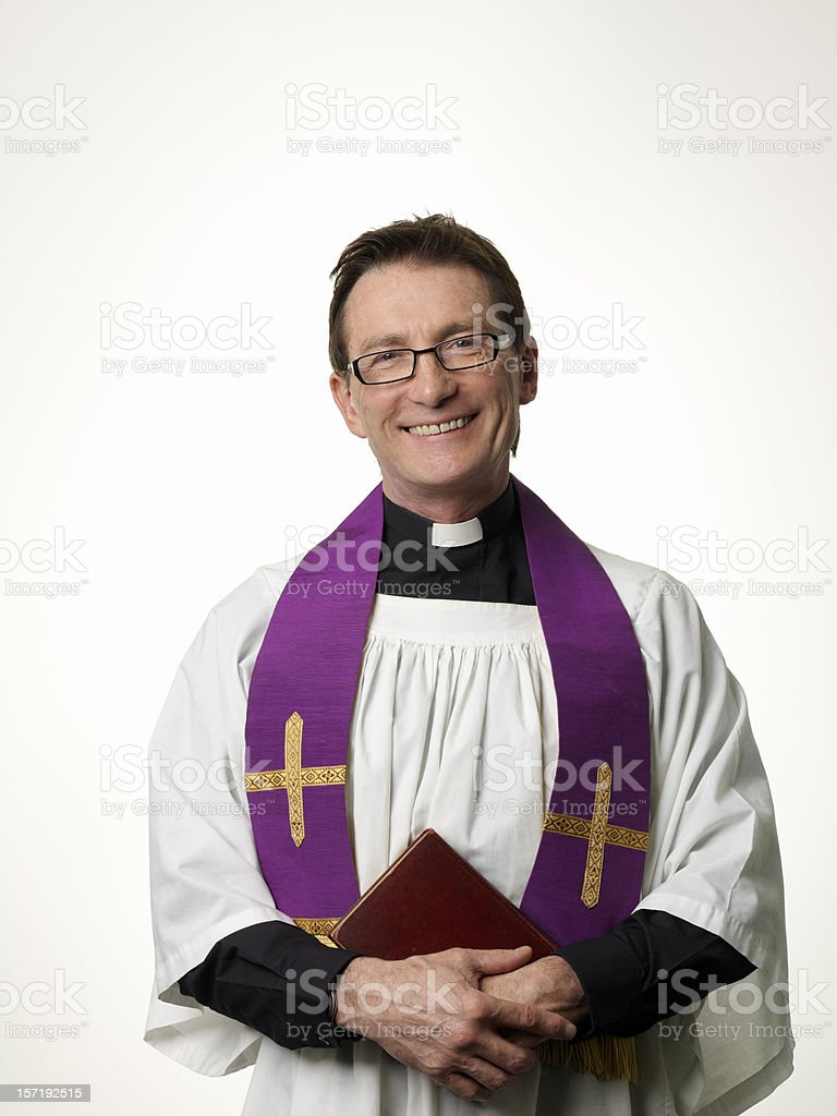 Smiling Priest stock photo