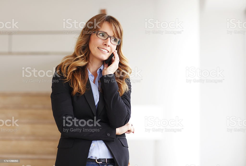 Smiling professional businesswoman on the phone royalty-free stock photo