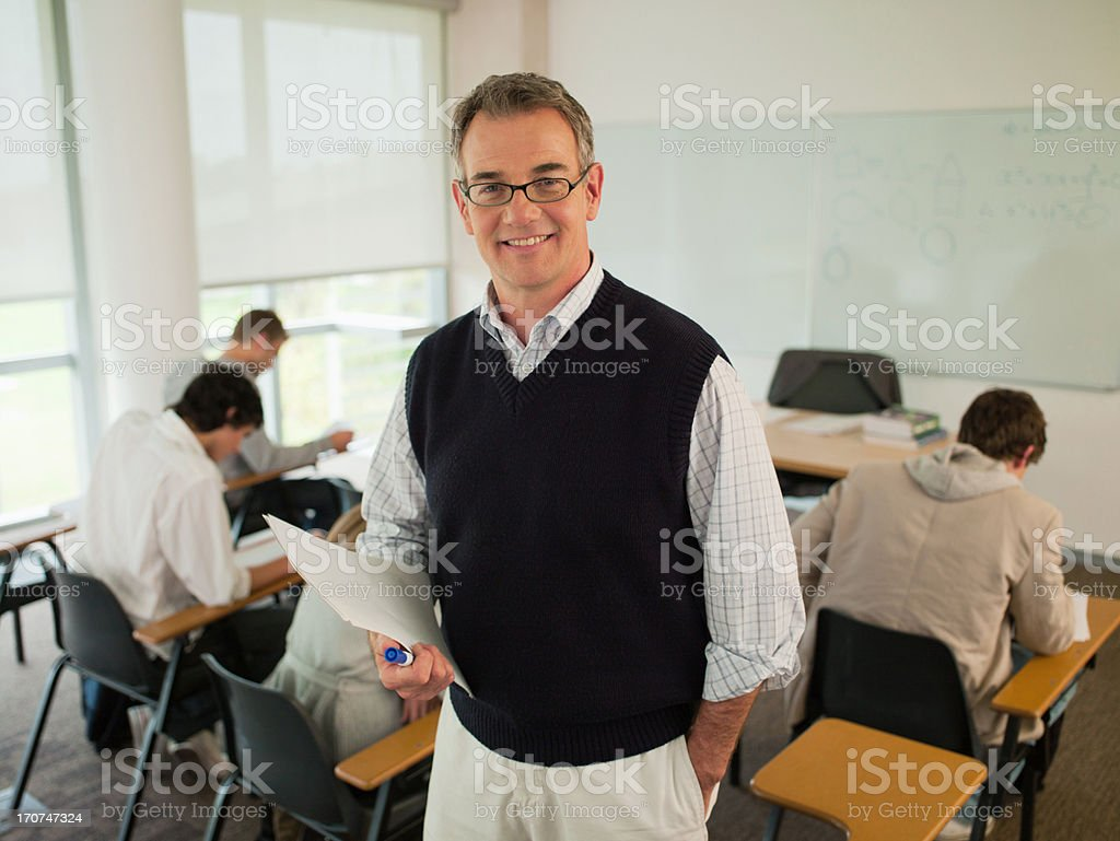 Smiling professor in classroom stock photo
