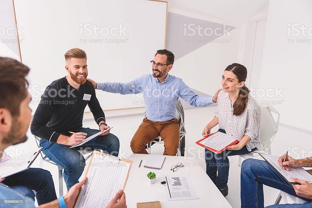 Smiling psychologist applying to neighbours stock photo