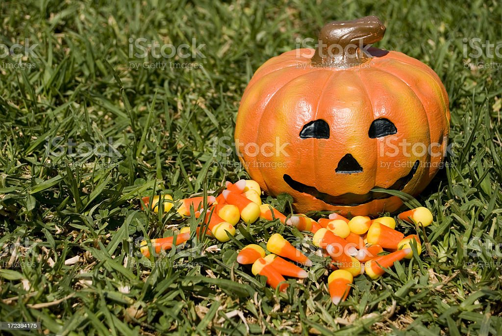 Smiling pumpkin and candy corn royalty-free stock photo