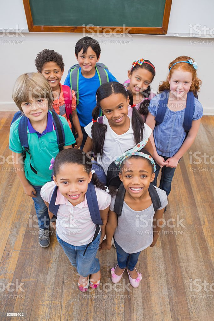 Smiling pupils in classroom stock photo