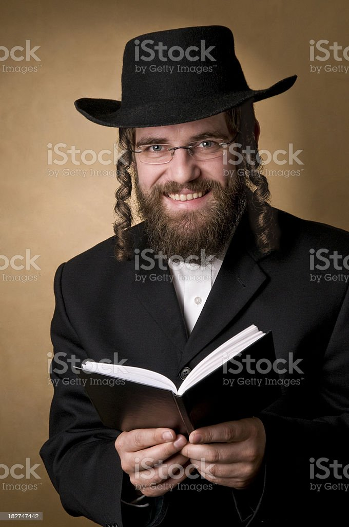 smiling rabbi holding a book royalty-free stock photo