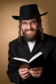 smiling rabbi holding a book