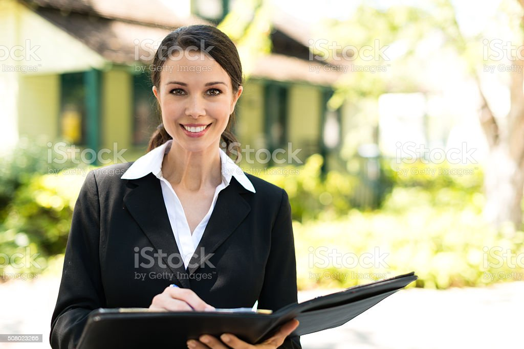 Smiling Real Estate Agent stock photo