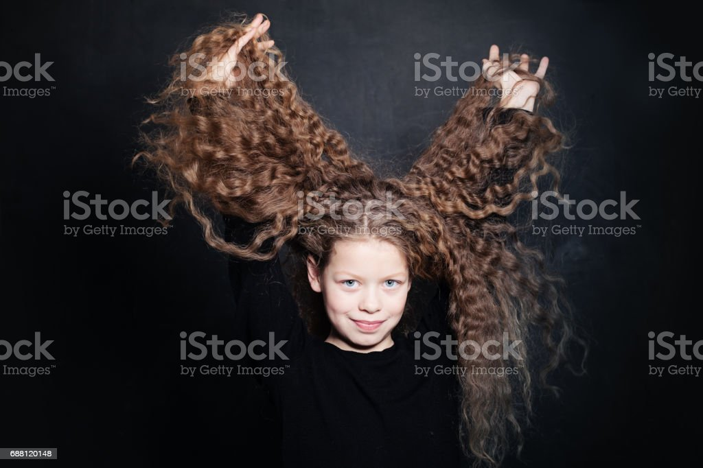 Smiling Red Hair Girl. Portrait of Child with Long Wavy Hair stock photo