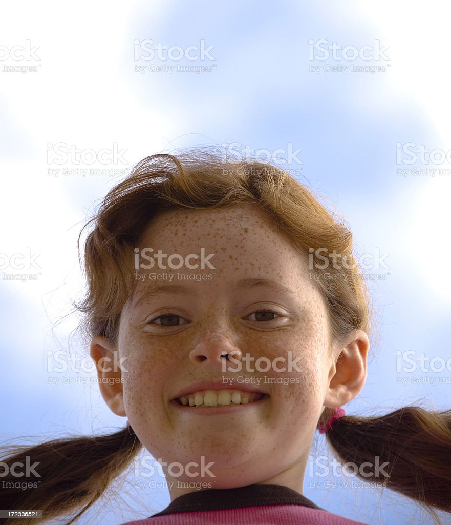 Smiling Redhead Freckle Face Pre Adolescent Girl Outdoors, Sky Background stock photo