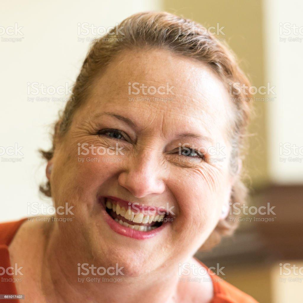 Smiling redhead mature woman stock photo