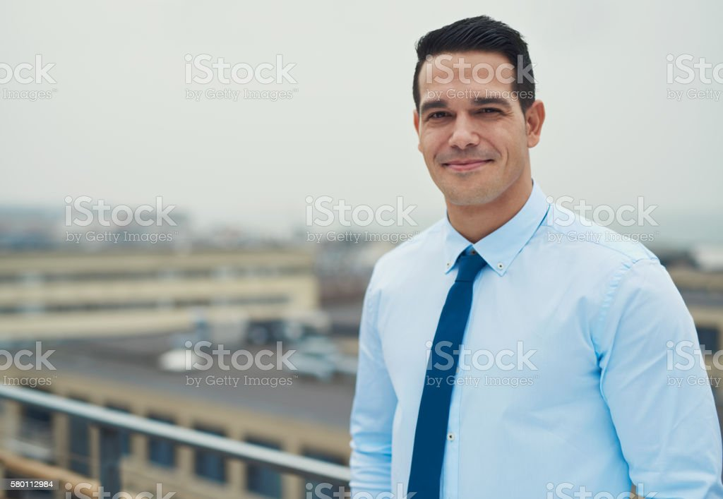 Smiling relaxed Hispanic businessman stock photo
