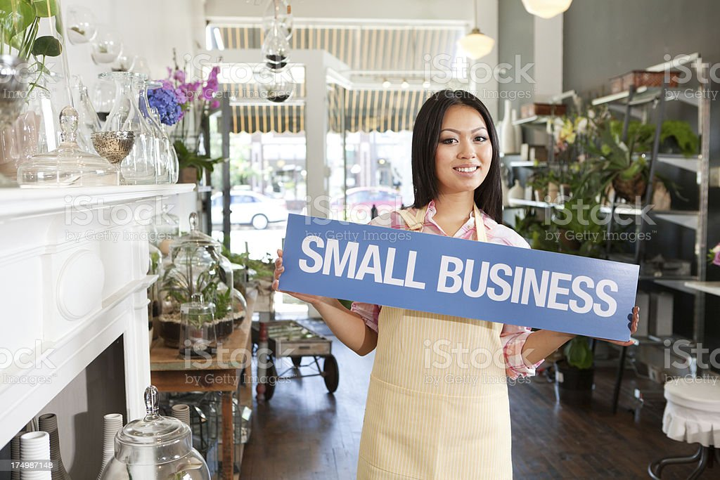 Smiling Retail Store Owner Entrepreneur with SMALL BUSINESS Sign Hz royalty-free stock photo