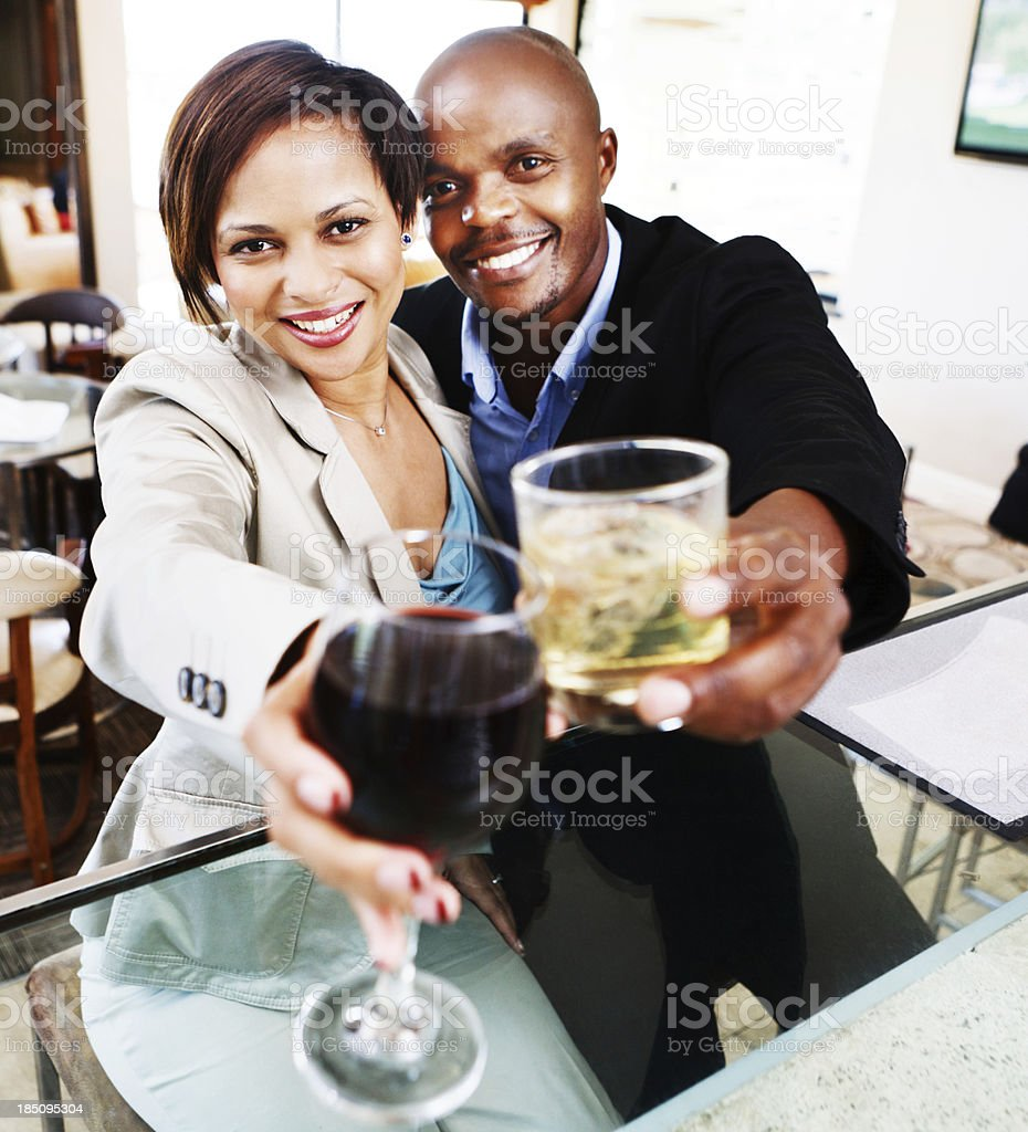 Smiling romantic couple toasting in bar royalty-free stock photo