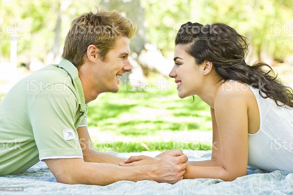 Smiling romantic young couple at park royalty-free stock photo