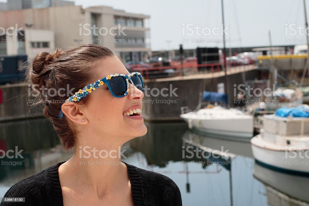 Smiling Russian outdoor girl with sunglasses Brighton Marina stock photo