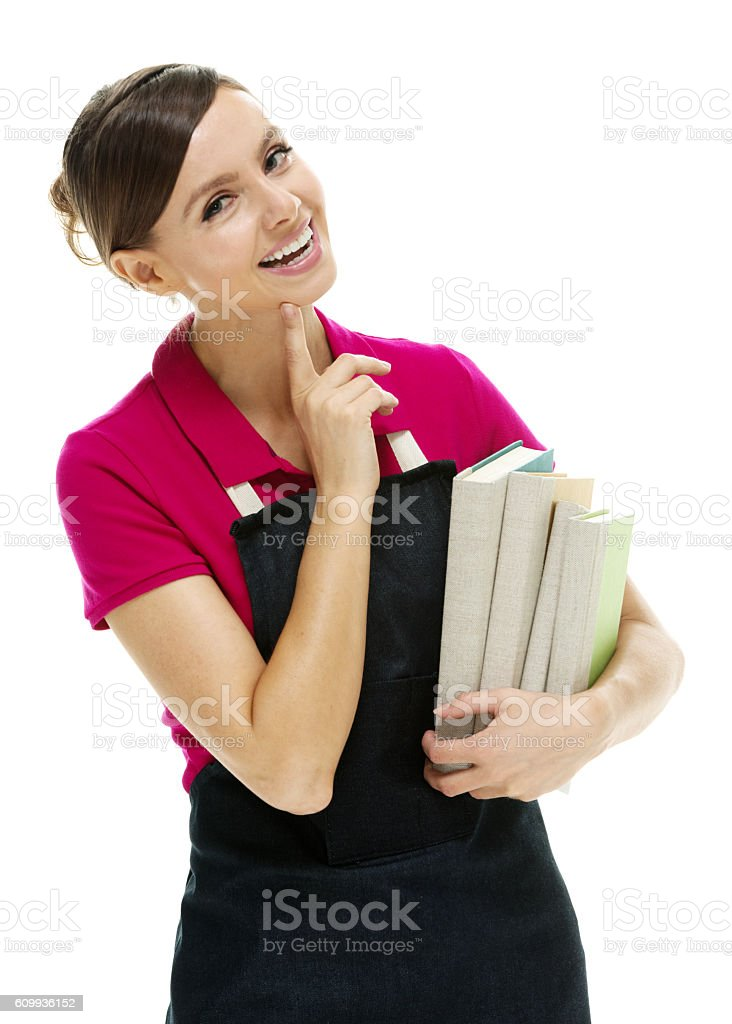 Smiling saleswoman holding books stock photo