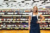 Smiling saleswoman in supermarket