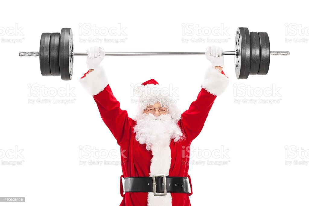 Smiling Santa Claus lifting a heavy barbell stock photo