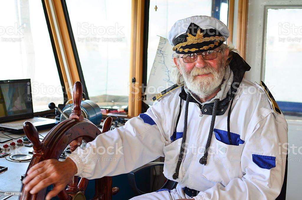 Smiling, satisfied captain, bon voyage stock photo