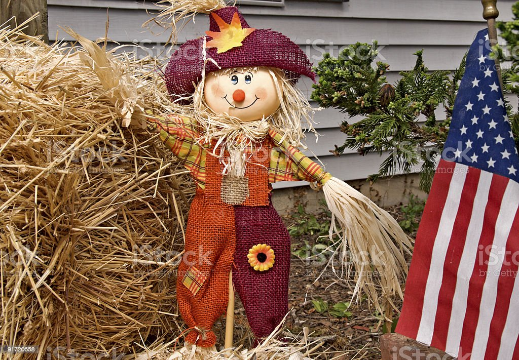 Smiling scarecrow American flag and bales of hay royalty-free stock photo