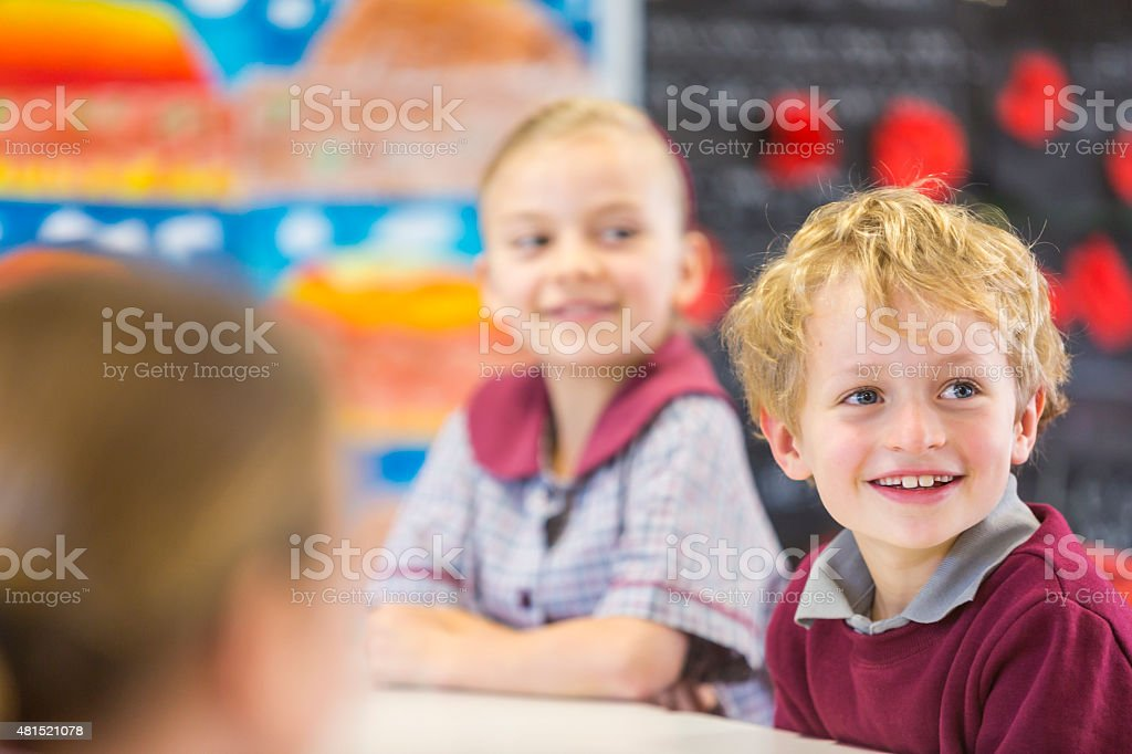 Smiling School Children Learning in the Classroom stock photo