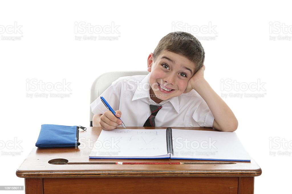 Smiling school pupil writing in a book royalty-free stock photo